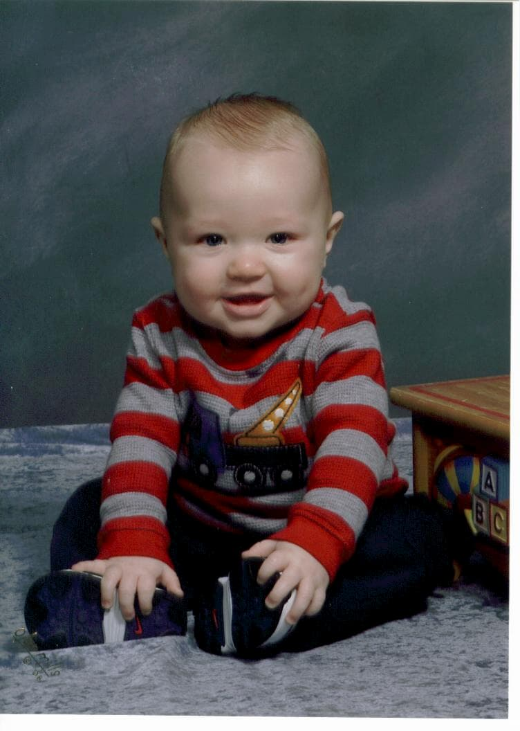 baby-boy-in-red-and-gray-striped-shirt