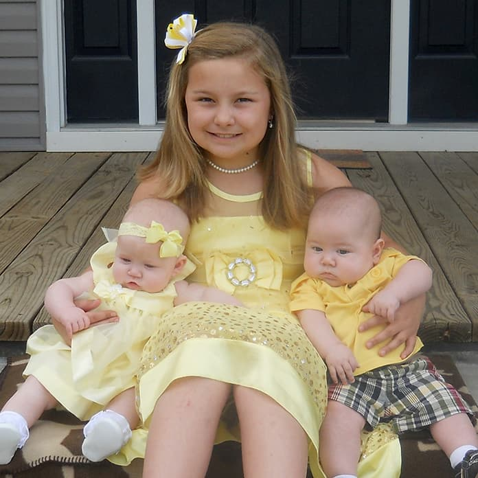 young-girl-in-yellow-dress-with-twin-babies