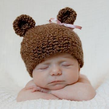baby-girl-wearing-knit-bear-hat