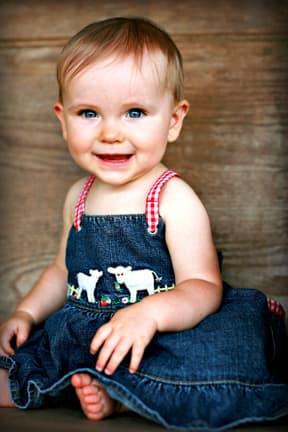 baby-girl-in-denim-dress